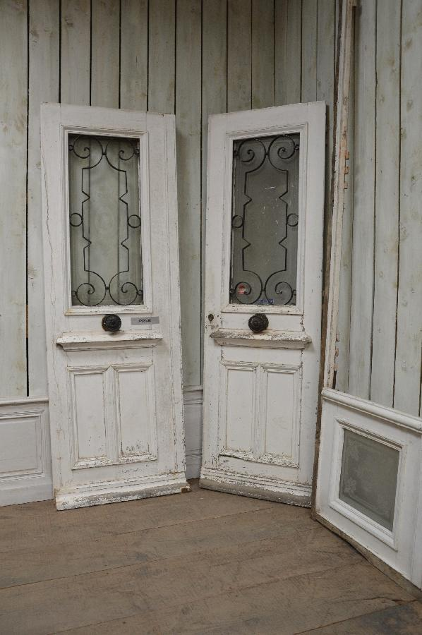 pair of painted entry doors with transom FAE477